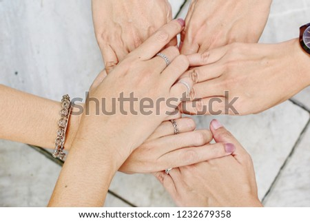 Women join hands touching for encouragingly to each other for stronger with love and tender, International woman's day or World peace day or Day for the Elimination of Violence Against Women concept