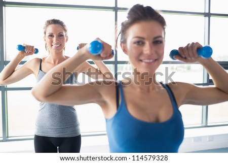 Women lifting weights in gym