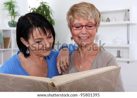 Women looking at a photo album