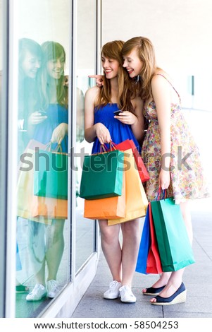 Women looking in shop window