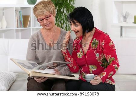 Women looking through photo-album