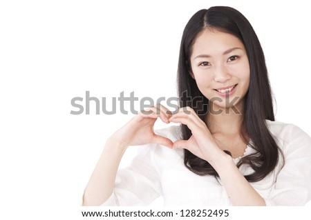 Women make a heart symbol by hand