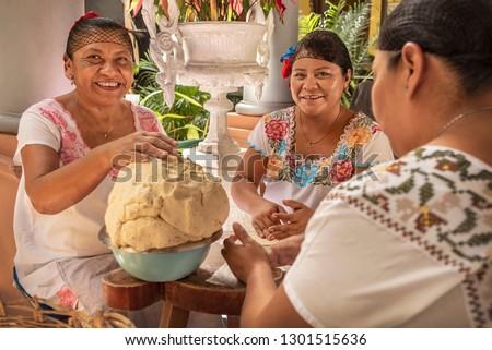 Women making Tortillas Group of smiling cooks preparing flat bread tortillas in Yucatan, Mexico