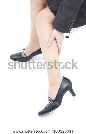Women massaging tired legs, isolated on white background
