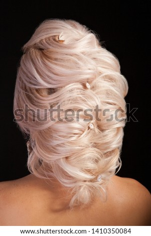 Women model shows haistyle with ornament for the bride isolated on studio background. Modern hair style. Caucasian woman.