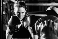 Women on boxing training . Black and white