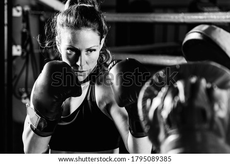Women on boxing training . Black and white Stock photo ©