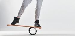 Women on Deck for balance board. Rocker-roller boards. Isolated oval wooden deck for balance board. solid plastic roller for balance board. Rocker-roller boards. Isolated