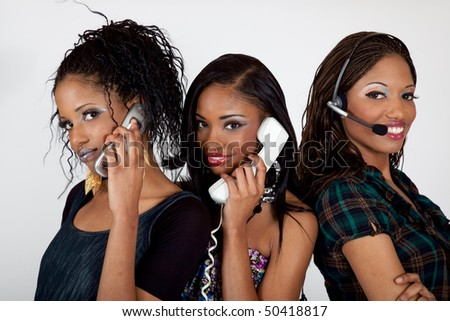 Women on the telephone, cell phone and headset