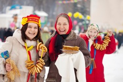 women plays during Pancake Week at Russia