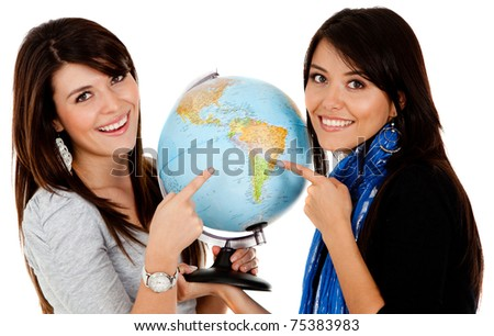 Women pointing at the globe - isolated over a white background