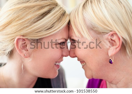 Women portrait with happy mom and daughter smiling, face to face, showing love and affection. Close up