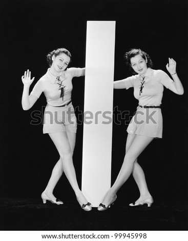 Women posing with big letter I