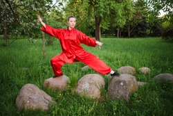 women practicing yoga and tai chi outdoors