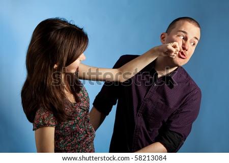 Women punching men. Studio shot