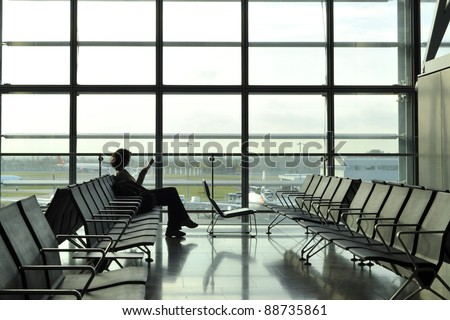 Women reading and waiting in the airport departure lounge