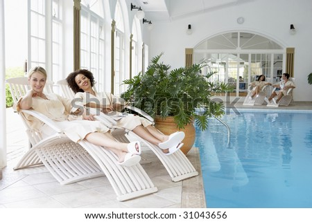 Women Relaxing Around Pool At Spa #31043656
