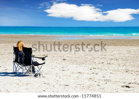 Women Relaxing on a beach with a cloudy sky