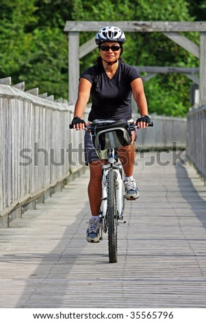 women rider crossing a bridge in Canada