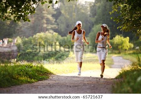 women run by sunny park