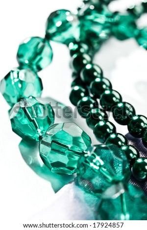 women\'s accessories: macro picture of green beads