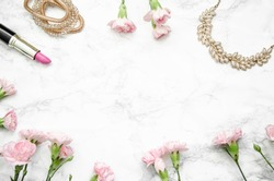 women's accessories with cloves on a marble background