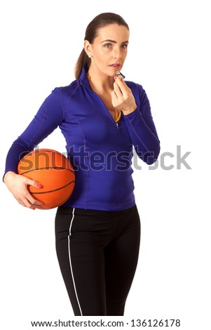 Women's basketball coach. Studio shot over white.