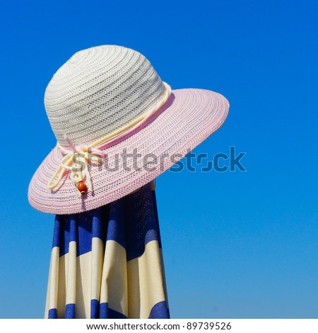 Women's beach hat against the blue sky