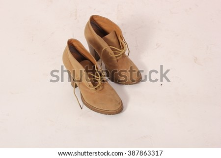 Women's beige boots with laces and wooden heels. In the studio on a white background. #387863317