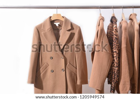 Women's brown blouses with, leopard pattern clothes , coat, jacket, sweater,  on hangers