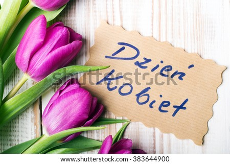 Women's Day card and a bouquet of beautiful tulips on wooden background, with Polish words 'Women's Day' Zdjęcia stock ©