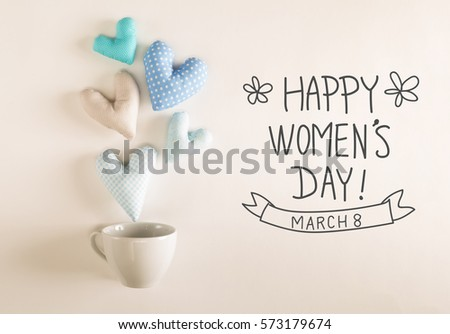 Women's Day message with blue heart cushions coming out of a coffee cup