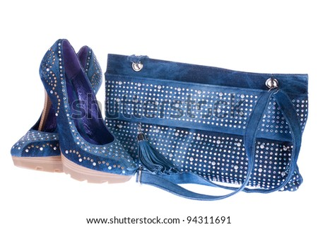 women's denim shoes and denim clutch bag, isolated on white background