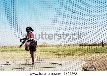 Women's discus competition at a college track meet.