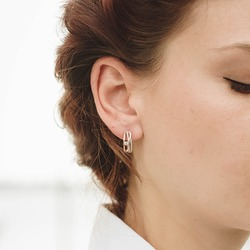 women's earrings with stones, jewelry, earrings at the ear of a beautiful girl, women's accessories, gold earrings, earrings with stones