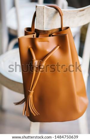 Women's fashion accessories. Leather woman handbag on white background.