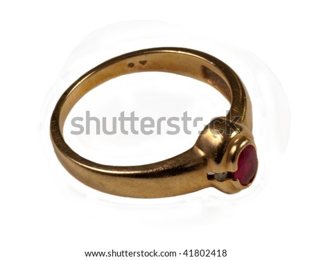 Women's gold ruby ring isolated