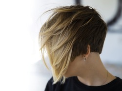 Women's haircut with active texture and disconnected zones.