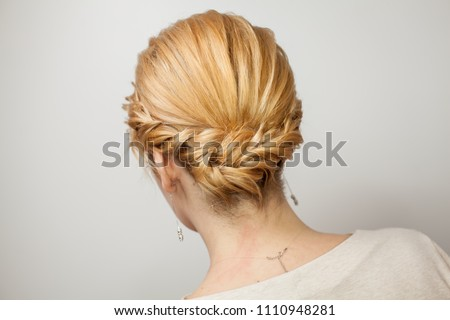 women's hairstyle. female hairstyle weaving. the girl in the beauty salon makes a hairdo. blonde with a beautiful hairdo #1110948281