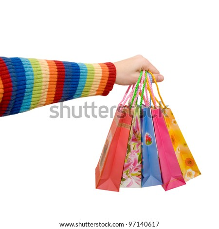 Women's hand in a rainbow colorful dress holding some shopping bags as logo. Isolated on white background with clipping path