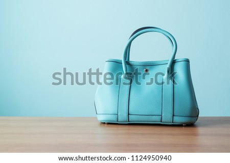 Women's handbag for ladies style or working women on wooden table ストックフォト ©