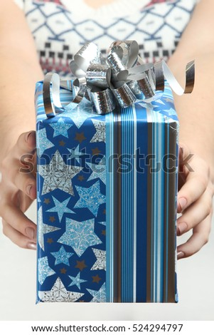 Women's hands are holding a gift. #524294797