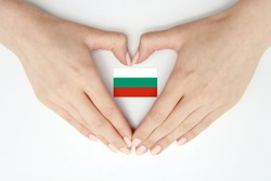 Women's hands create a heart inside the flag of Bulgaria on a white background.Background for postcards, articles for Flag Day, Independence Day,Unification Day of Bulgaria,travel,patriotism,tradition