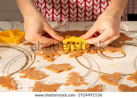 Women's hands cut out shapes for cookies stock photo
