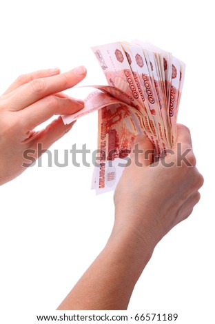 Women's hands feel of paper money. Five thousand. Isolated on white background
