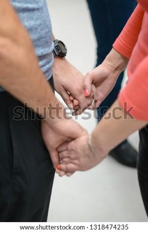 Women's hands in male hands. #1318474235