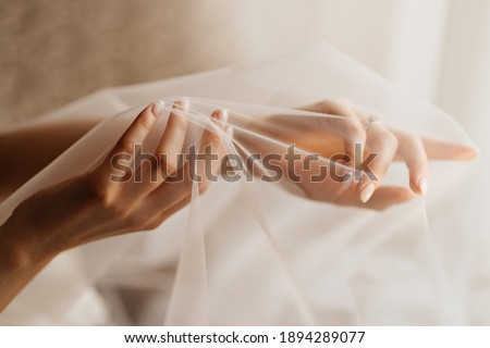 women's hands of the bride under the veil. Tenderness. wedding photo shoot. advertising of hand-care products. Stockfoto ©