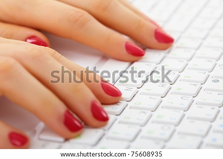 Women's hands on a computer keyboard close up - typing - stock photo