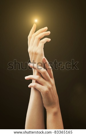 Women's hands on isolated a black background