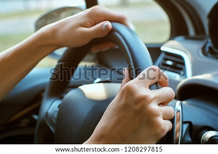 women's hands on the wheel #1208297815
